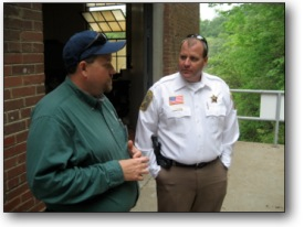 Sheriff Armentrout Talking to Man in Green Shirt